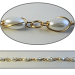 Wholesale Chanel Footage Wrapped Pearl Chain 10x6mm pearls wrapped in a gold plated setting, sold in 10 Feet minimum lengths.