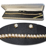 "Wholesale Genuine Cubic Zirconia Set Dazzling gold plated CZ bracelet & earrings, 7 1/2"". Comes with silver gift box."