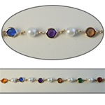 Octagon & Pearl Crystal Lucite Chain Multi colored crystal lucite stones in silver plated setting. 8 colored stones with alternating 8mm pearls, sold in 10 Feet minimum lengths.