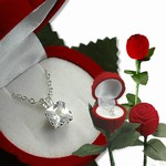 One long stem rose (velvet) secretely and surprising contains a 2 kt total CZ weight (6.5mm) square Princess cut, brilliant white Cubic Zirconia Pe
