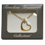 Wholesale A Free Form, cut out heart necklace captured by a bail with crystals on an 18 inch gold tone cable chain, boxed.(Min. order 3 sets)