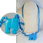 "Wholesale Beautiful Synthetic Turquoise Elephant Pendant Necklace.  Elephant Pendant 1 3/4"" x 2"",  8mm beads, 24"" long."