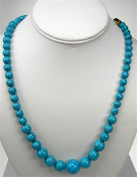 Beautiful Synthetic Turquoise Necklace. Graduated round beads are 6mm-16mm in size. Necklace is 24 inches long with silver plated clasp