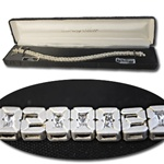 "Sterling Silver Cubic Zirconia Bracelet Dazzling ""2000"" Millennium Bracelet, 6mm CZ stones set in sterling silver, 7 1/2"". Comes with black gift box.