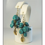 Wholesale Genuine Turquoise Earrings Fabulous turquoise nuggets with gold tone bead & feather accents.