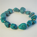 Wholesale Genuine Turquoise Bracelet Fabulous turquoise nuggets with gold tone bead accents, on a stretch bracelet.